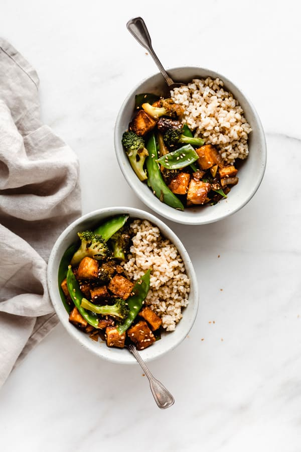 two bowls of tofu stir fry with rice