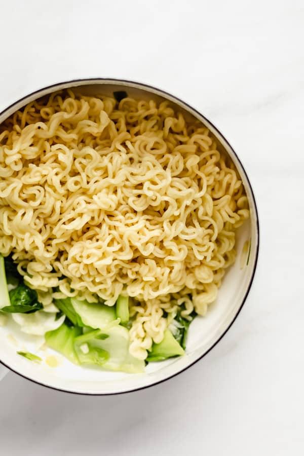 Ramen noodles in a white pot