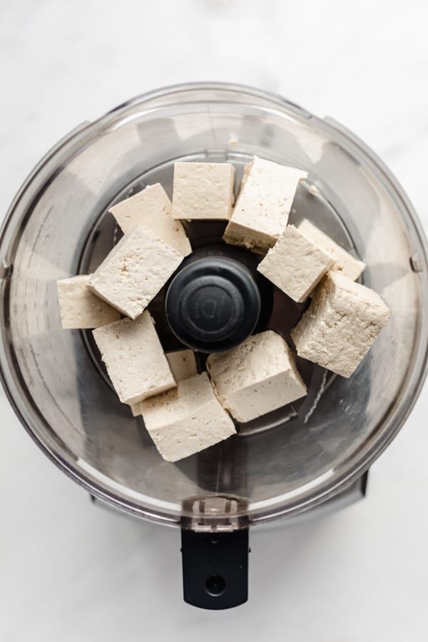 large cubes of tofu in a food processor