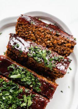 lentil loaf sliced topped with fresh parsley