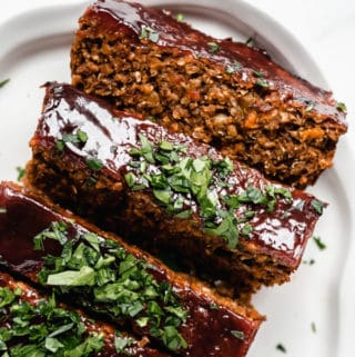 lentil loaf sliced topped with fresh parsley