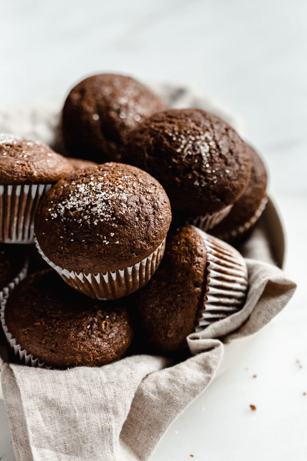 gingerbread muffins piled on top of each other sprinkled with sugar