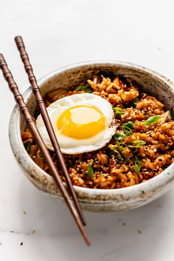 a side angle of a bowl with kimchi fried rice in it