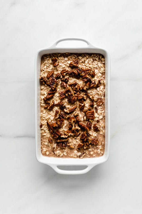 unbaked pecan pie oatmeal in a white baking dish