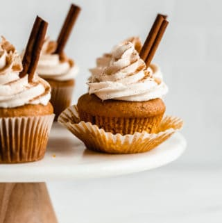 pumpkin spice latte cupcakes on a marble cake stand
