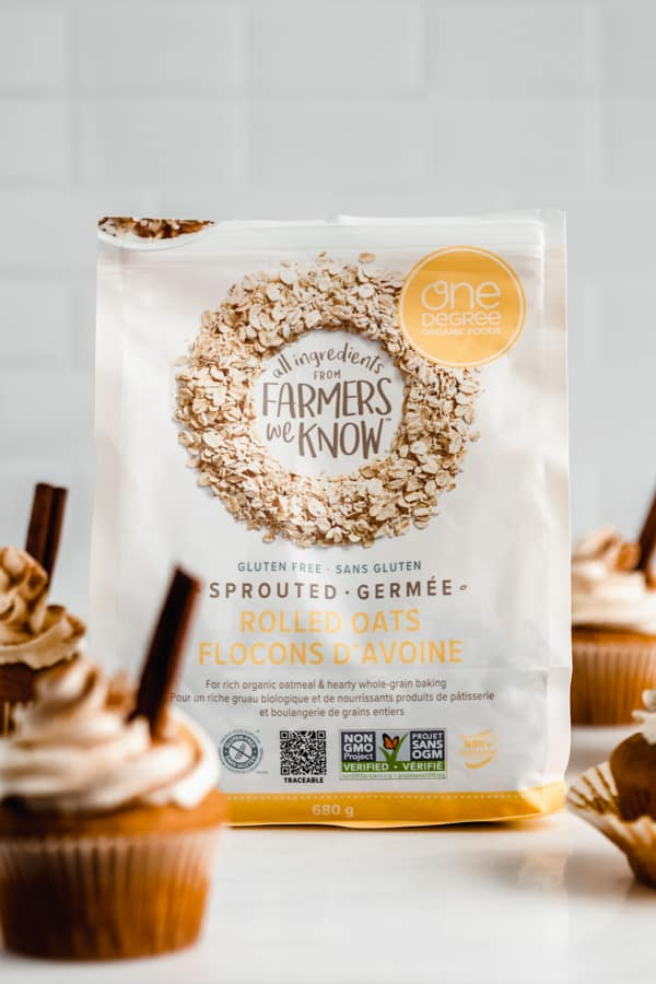 a bag of one degree organics sprouted rolled oats surrounded by pumpkin cupcakes