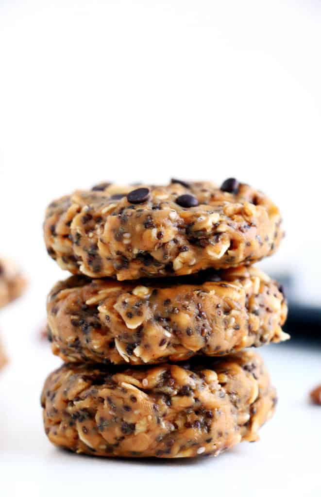 stack of three healthy breakfast cookies topped with chocolate chips on a white countertop