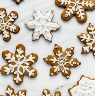snowflake gingerbread cookies on a marble board