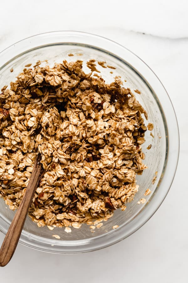 a clear mixing bowl with banana bread granola in it
