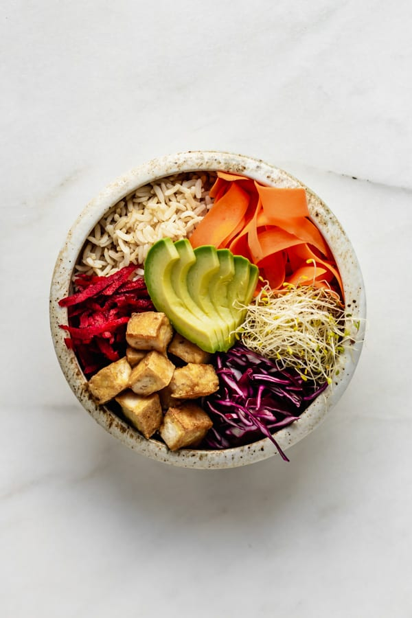 a dragon bowl with tofu and veggies in it