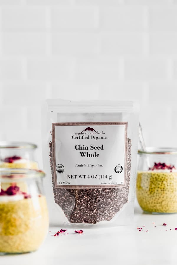 a package of chia seeds with jars of chia pudding around it