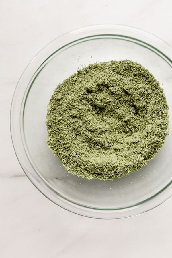 A bowl of matcha powder and almond flour