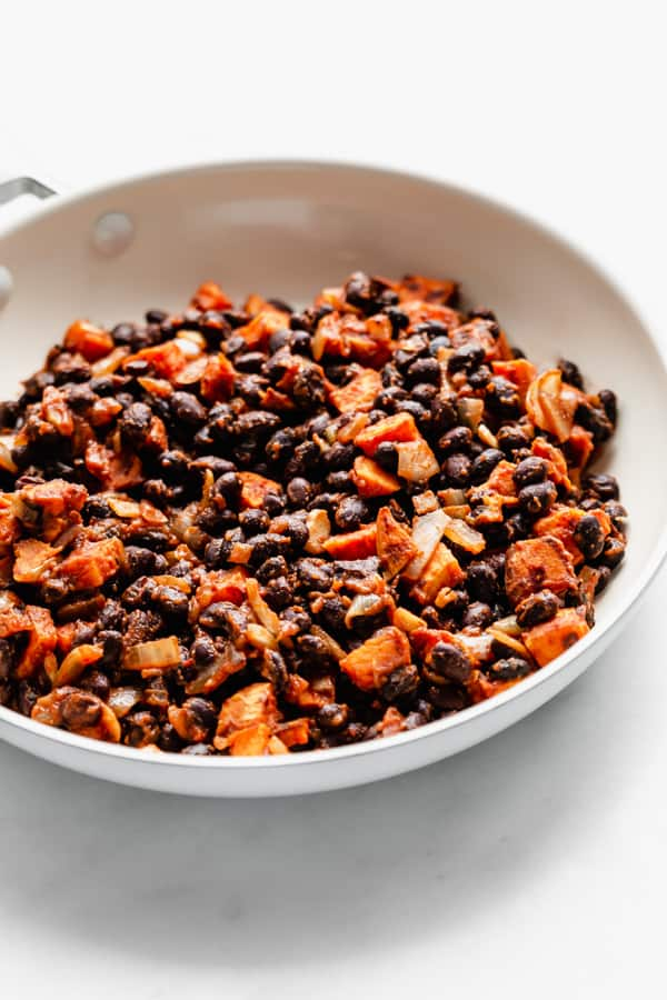 black beans and sweet potatoes in a white pan