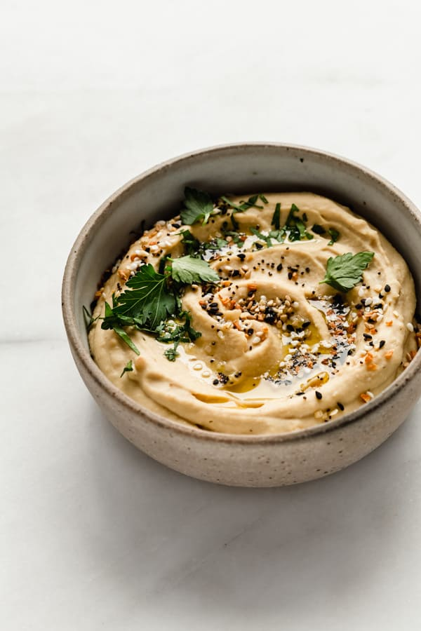 everything bagel hummus topped with olive oil, spices and parsley