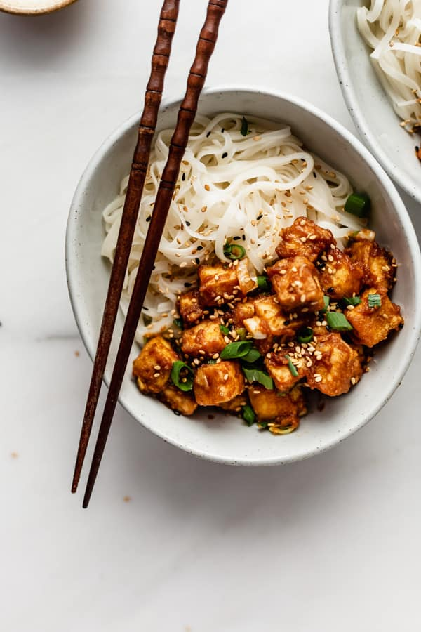 a bowl of peanut butter tofu with rice noodles