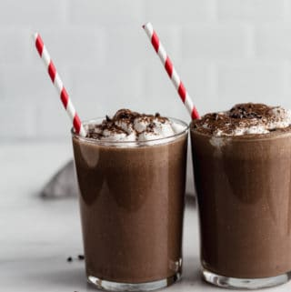 two glasses of frozen hot chocolate with red straws in them