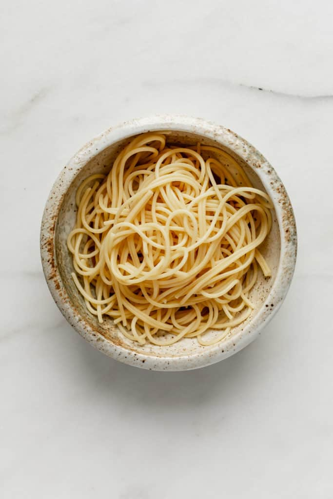 spaghetti noodles in a white ceramic bowl