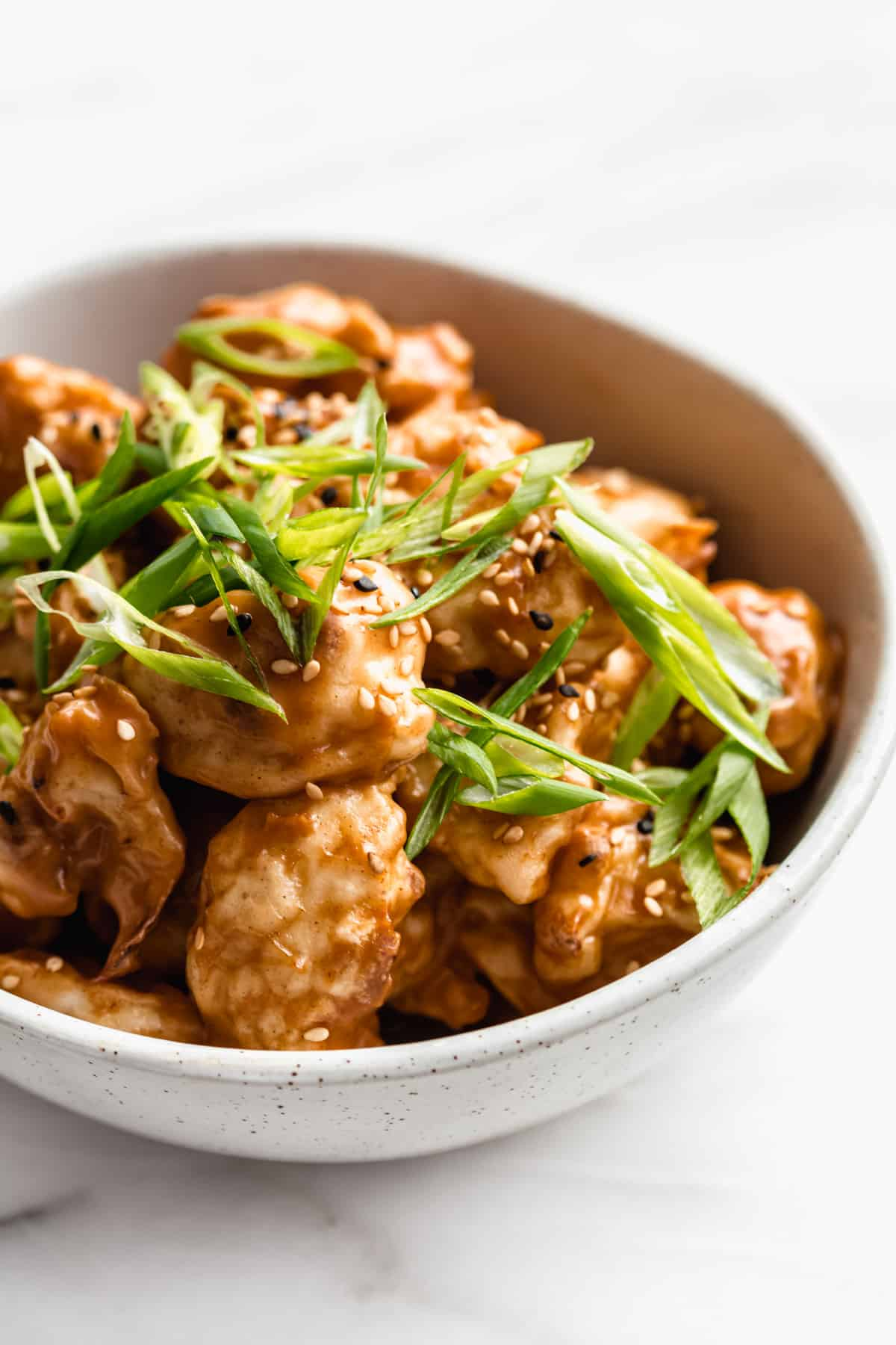 Thai peanut cauliflower wings in a bowl