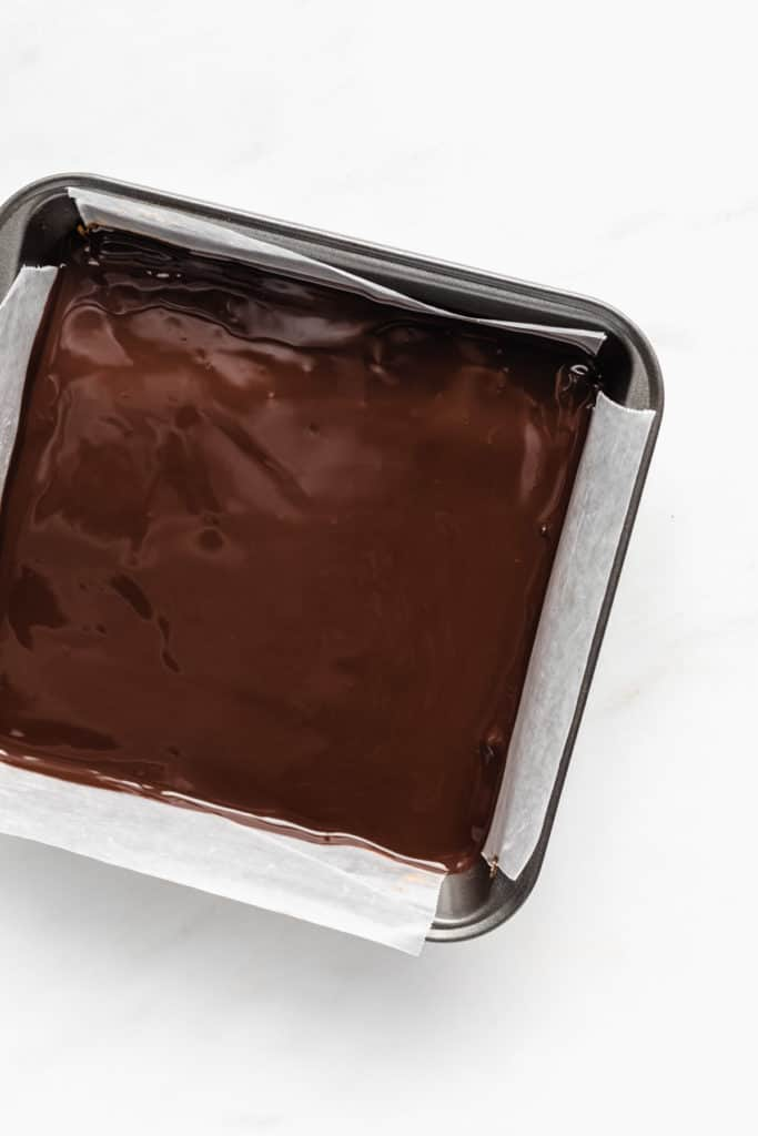a silver 8x8 inch pan with chocolate in it