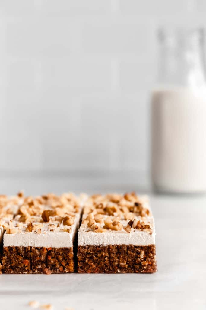 raw carrot cake topped with walnuts