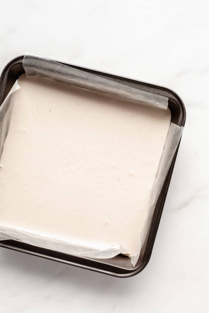 raw cashew cream in an 8x8 inch pan