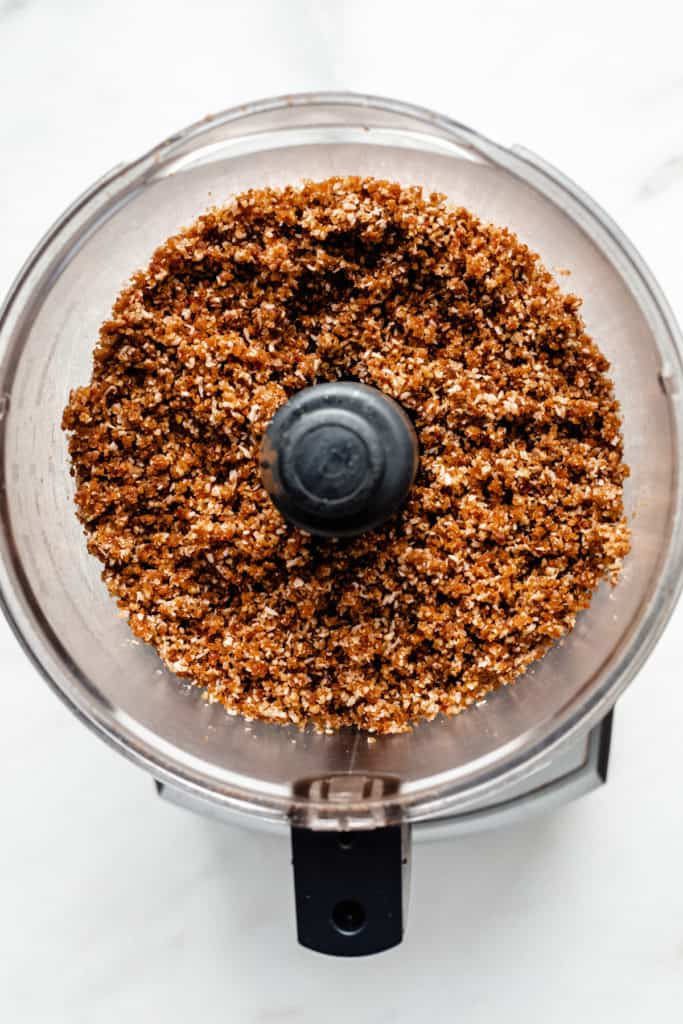 a crumbly raw mixture of dates and nuts in a food processor