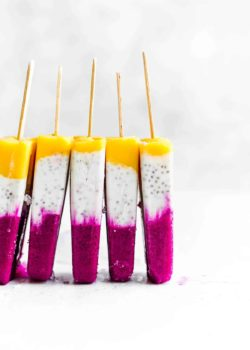 5 tropical coconut chia popsicles stacked next to each other
