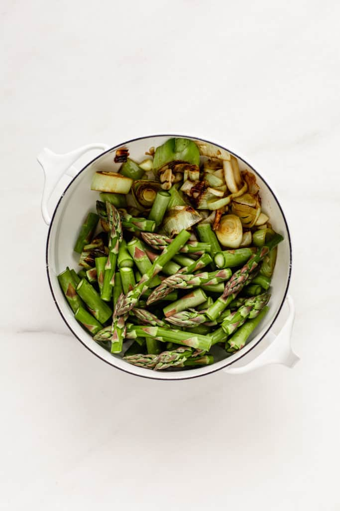 leeks and asparagus in a white pot