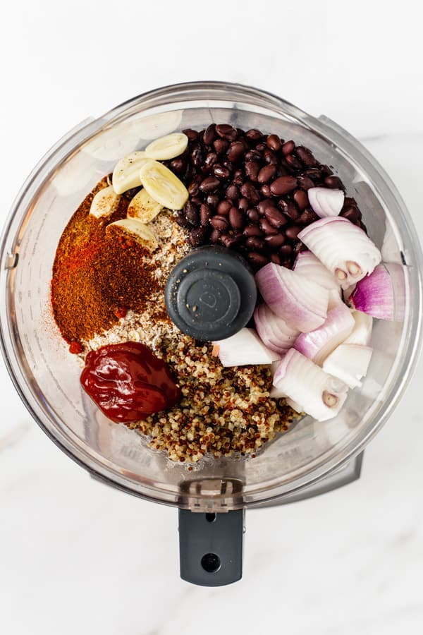 black beans, quinoa, spices, onions and garlic in a food processor