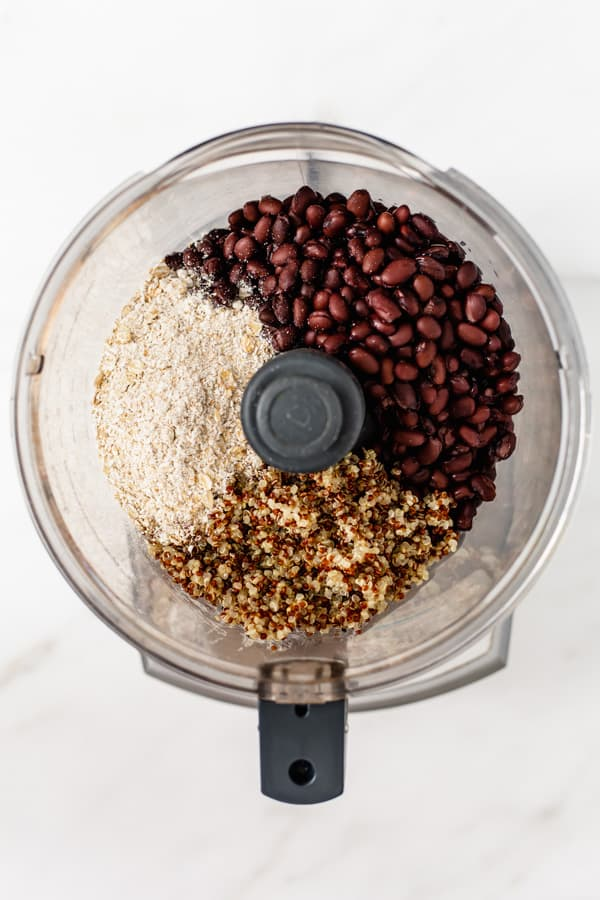 black beans, quinoa and ground oats in a food processor