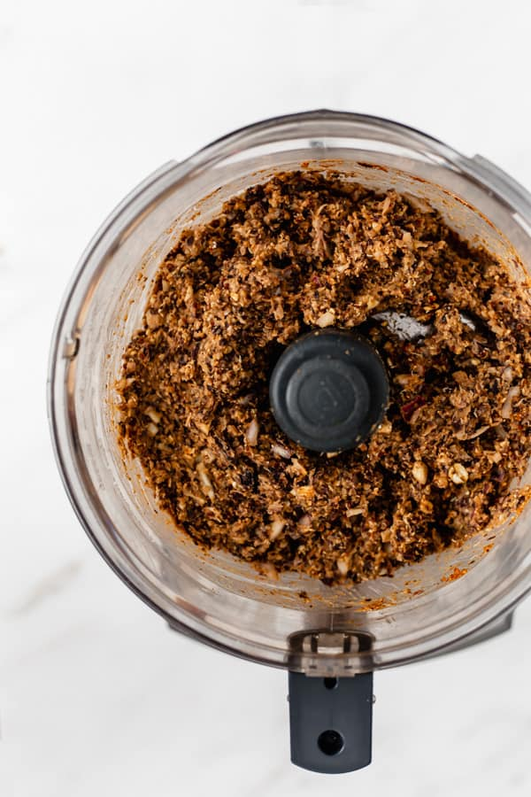 ground black beans and quinoa in a food processor