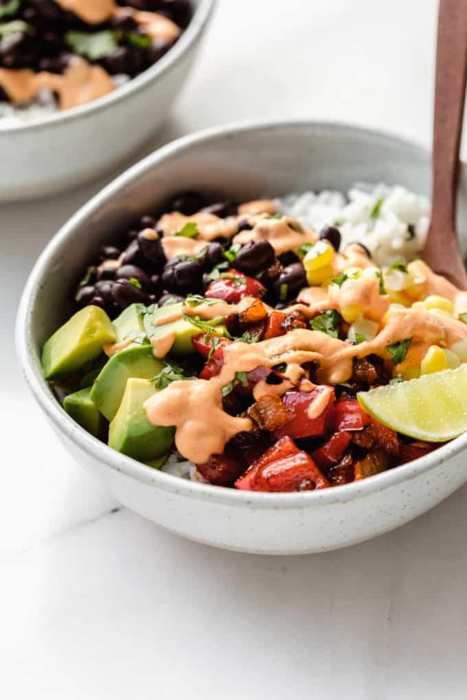 a vegan burrito bowl topped with chipotle crema