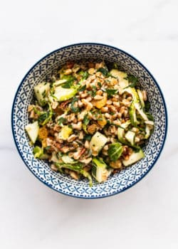 a blue and white bowl with farro salad in it