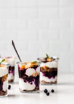 Jars of yogurt and granola parfaits