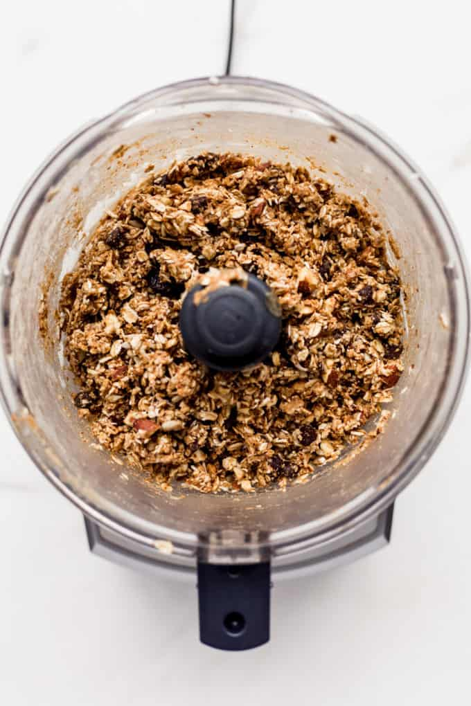 a food processor with energy ball mix in it