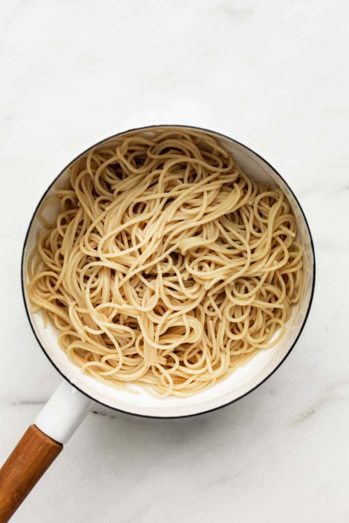 brown rice spaghetti noodles in a white pot