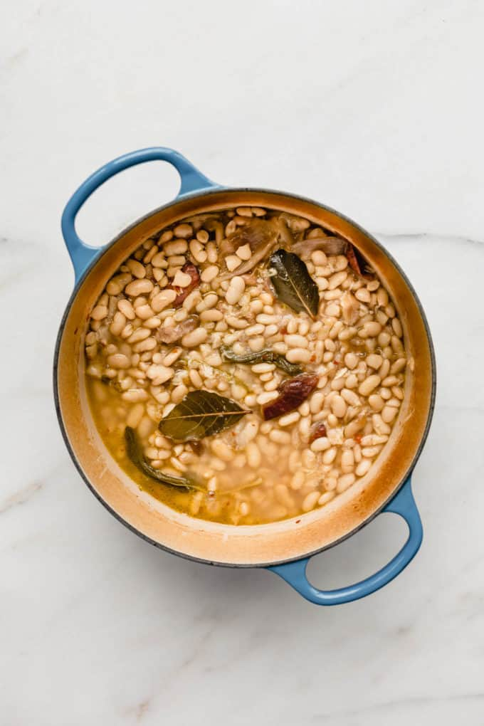 A blue pot filled with beans in borth