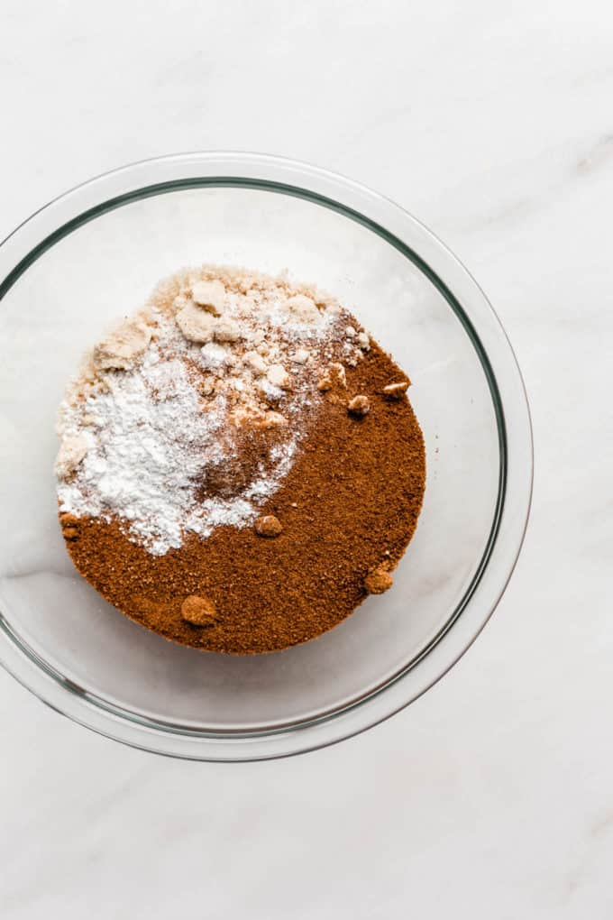 Coconut sugar and almond flour in a clear mixing bowl