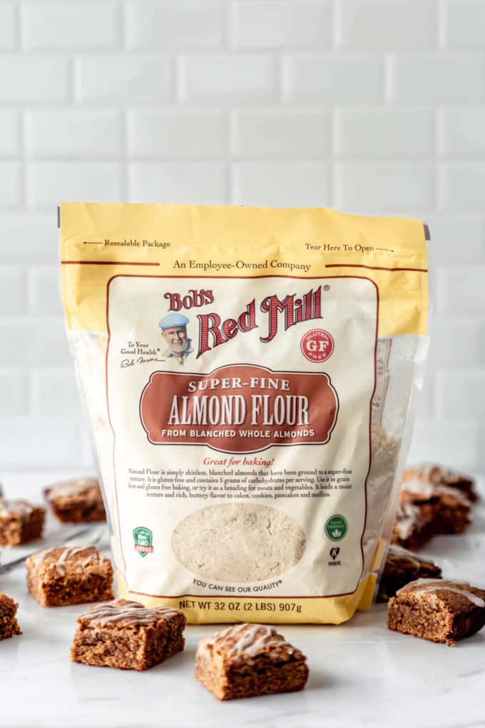 a bag of Bob's Red Mill Almond Flour on a marble counter with blondies around it