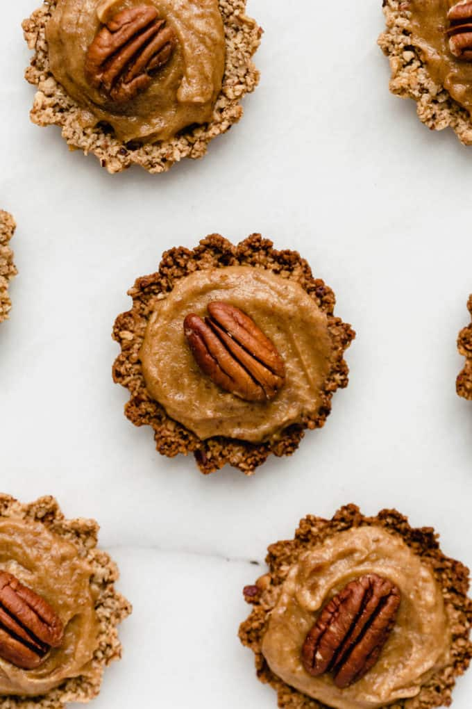 mini pecan pie topped with date caramel and a pecan