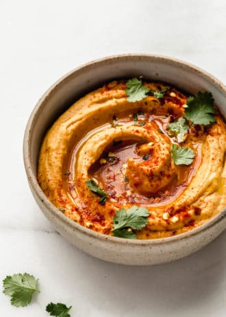sweet potato hummus in a speckled ceramic bowl