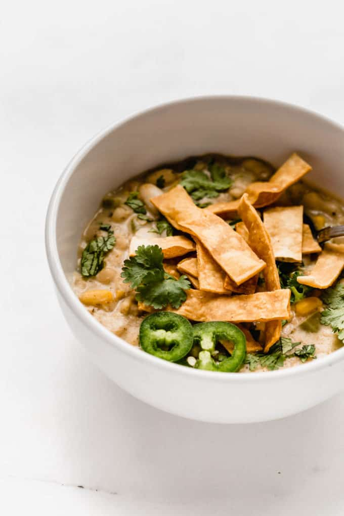 white vegan chili in a while bowl
