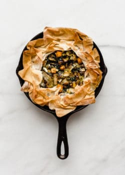 A veggie skillet phyllo pie baked in a cast iron skillet