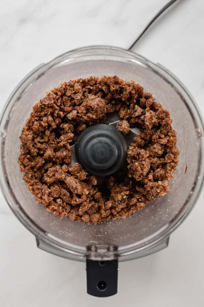 a food processor with blended dates in it