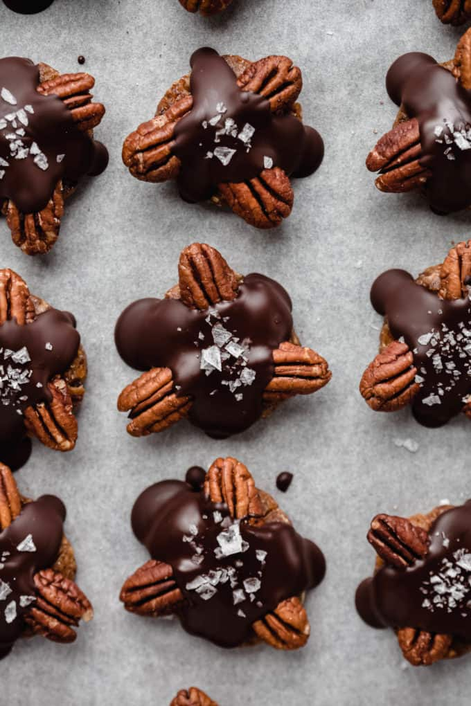 healthy chocolate turtle candies on a baking sheet
