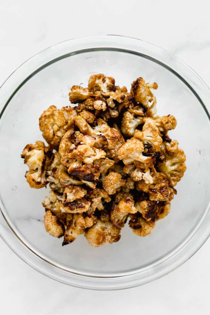 kung pao cauliflower in a clear mixing bowl