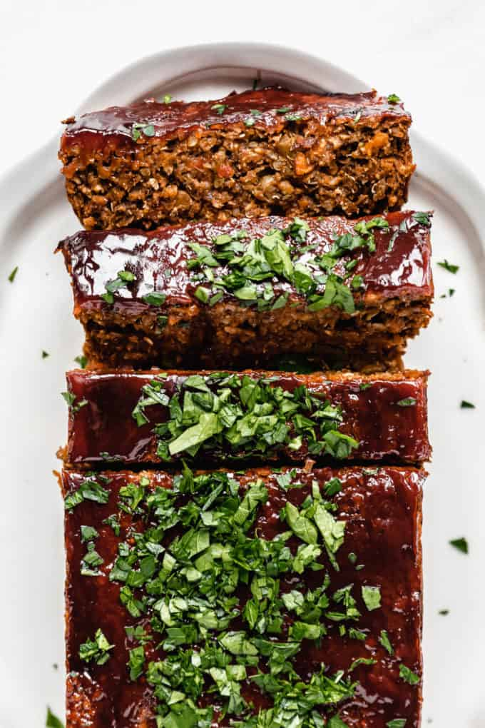 A vegan lentil loaf topped with a ketchup glaze and parsley