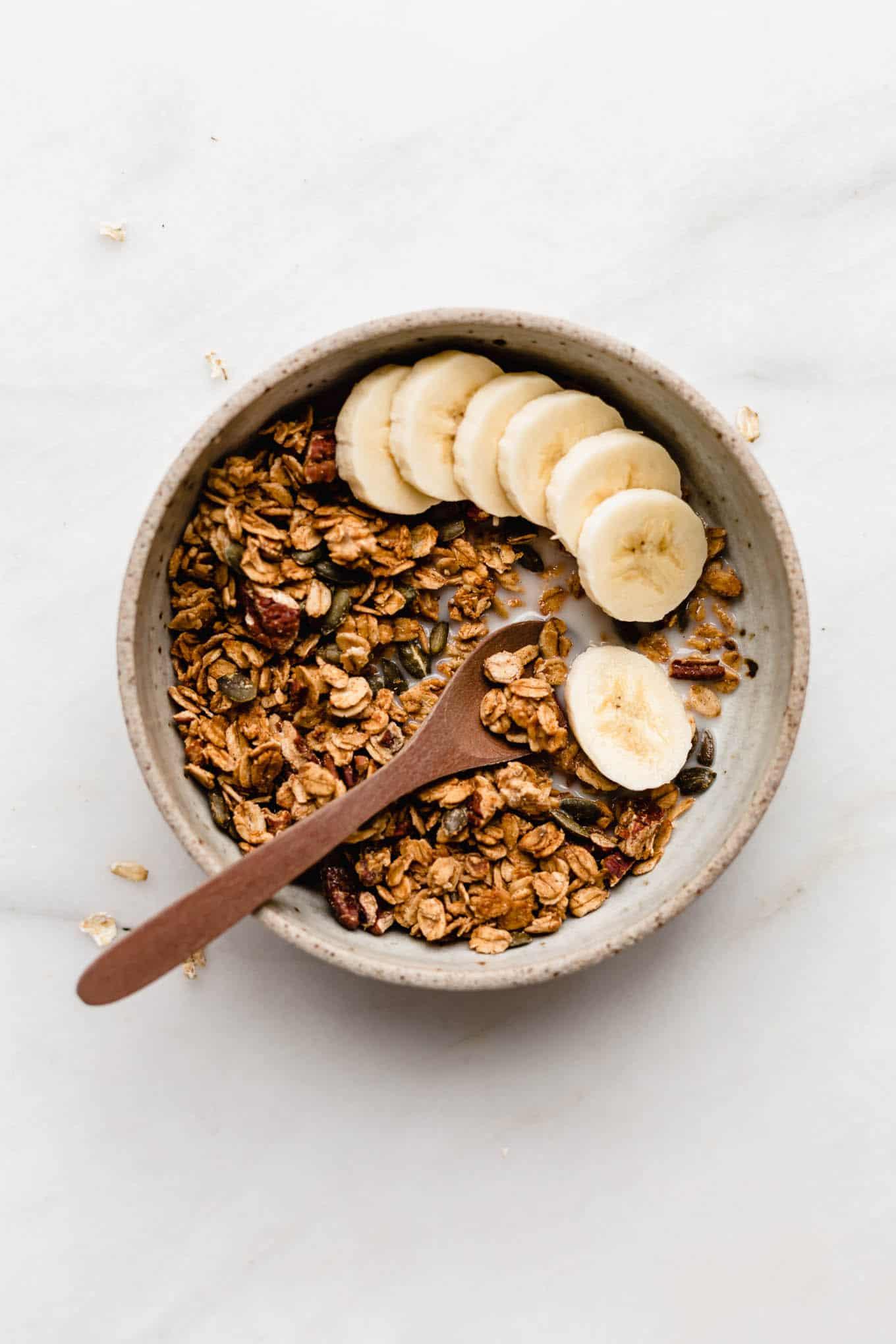 healthy pumpkin desserts - pumpkin granola with bananas in a bowl