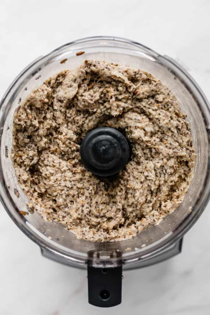 a food processor with blended buckwheat groats and chia seeds in it