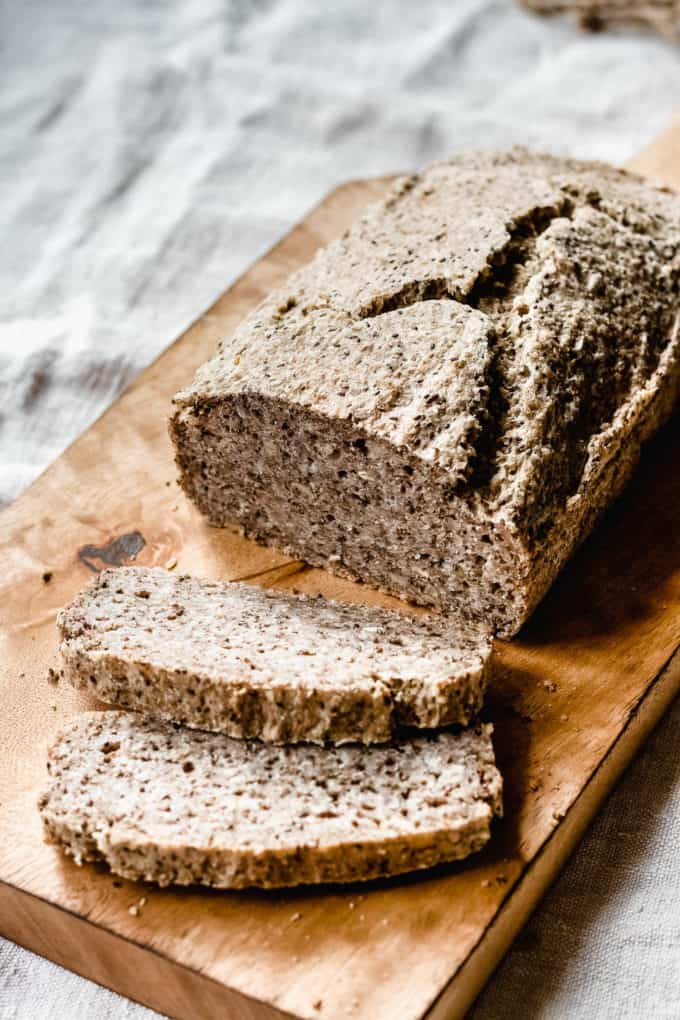 a loaf of buckwheat and chia seed bread on a bread board